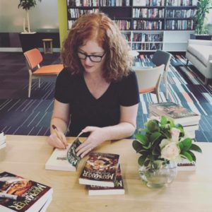 A.L. Tait signs copies of The Mapmaker Chronicles