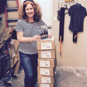 A.L. Tait with boxes of The Book Of Secrets (Ateban Cipher #1) at her local bookshop